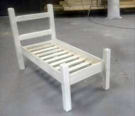 Raw wood solid pine toddler bed.