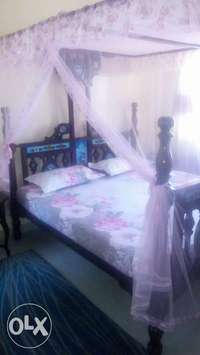 6 by 6 Swahili hardwood bed 0