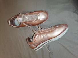 Pre-owned Nike Cortez rose gold.