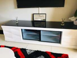 Glossy white and black glass top Tv stand from Essops