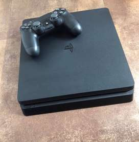 Playstation 4 for sale. Only 6 months old. Mint condition