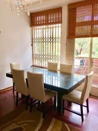 Image of Dining room table and chairs
