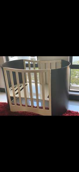 Baby cot + chest of drawers + floating shelves
