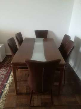 Dining table glass top n six leather chairs