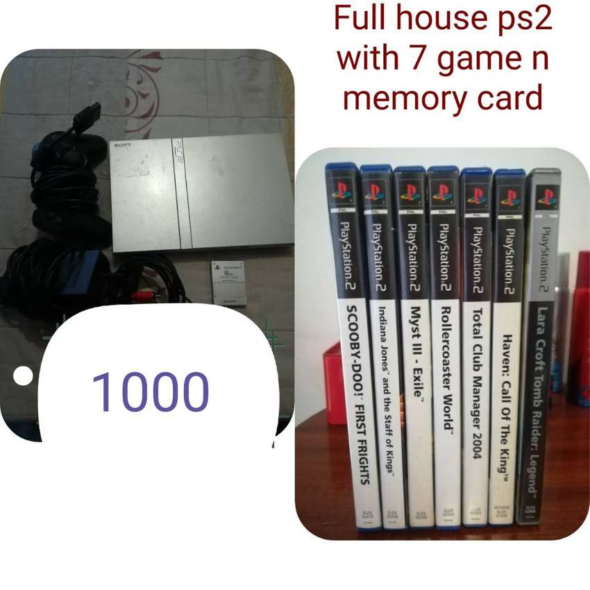 Ps2 with 8 games 0