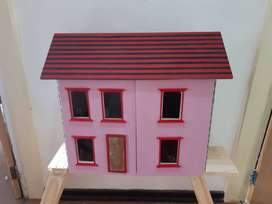 Wooden doll house with miniture furniture