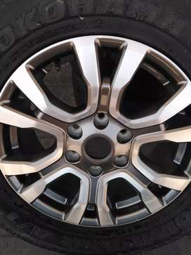 """18"""" Ford Ranger wildtak mag rim and a tyre as a spare wheel."""