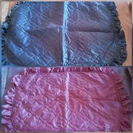 Total of 7 pillow slips. 4 x pink, 2 x blue 1 x cream R110 for the lot