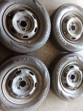 Set of 13 inch Renault Kwid rims with tyres & wheel caps for sell
