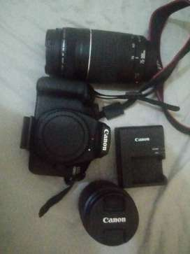 Canon 4000D with double lence and tripod stand