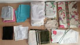 Over 20 table cloths, place mats etc