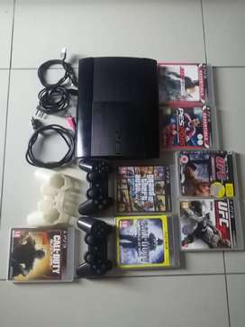 Ps3 slim with 7 games and 2 controllers