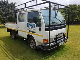 2009 Nissan Cabstar F23 Double Cab, dropside body