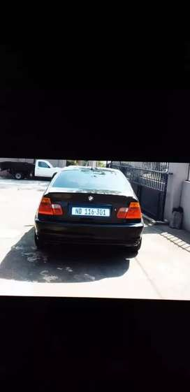 The car is neat , stock Engen , black , cream sites