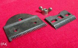 Комплект ножей от механической машинки для стрижки.