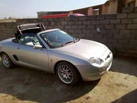 2 door British made vehicle with soft top manual operated top
