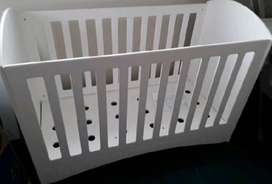 Tree house cot with side bumper cushion.