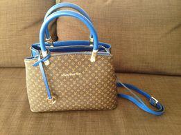 Продам кожаную сумку Louis Vuitton