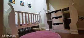 Wooden Sleigh cot with compactum