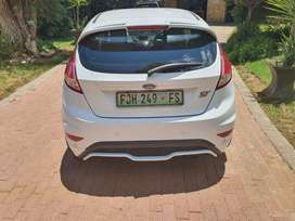 Ford fiesta ST (2013) and Opel corsa utility sport (2010)