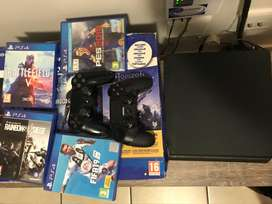 Sony PS4 1TB Slim Console + 2 Controllers, 7 Games