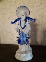 Продам фарфоравую статуэтку китайского рыбака