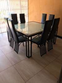 Image of 8 seater, square modern dining table with customized glass