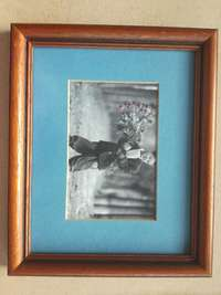 Image of Frame With Glass & Classic Boy And Girl Pictures With Blue Background