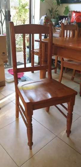 Six seater Oregon Pine dining room table and four chairs.