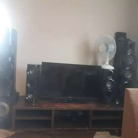 Tv stand,tv and sound system