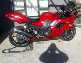 Showroom condition zx14 with Scorch exhaust system up for grabs.