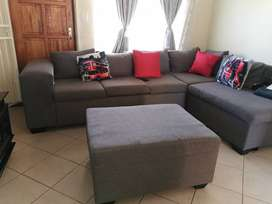 """Grey """"L"""" shaped sofas. Price is negotiable"""