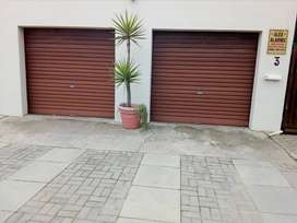 Two Roll up garage doors with motor