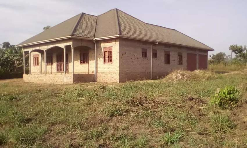 I have in Kasangati. Six bedrooms with two garages on 80decima 0