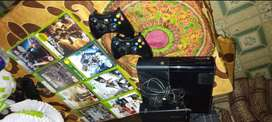 xbox 360 console with 2 controllers and  8 games