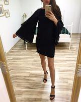 Czarna sukienka SIMPLE , plisowany rękaw , dopasowana nowa
