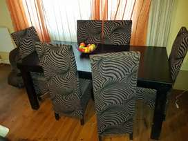 dining room table,  still like new plus six chairs