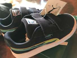 Puma kids blue and neon sneakers