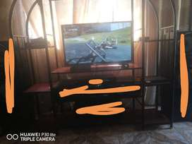 TV stand and TV and Dstv decoder