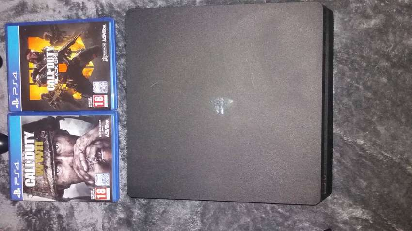 PS4 1TB with remote and 2 games 0