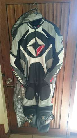 motorcycle race suit and boots and pannier bags