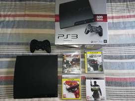 Playstation 3 with remote and 4 games