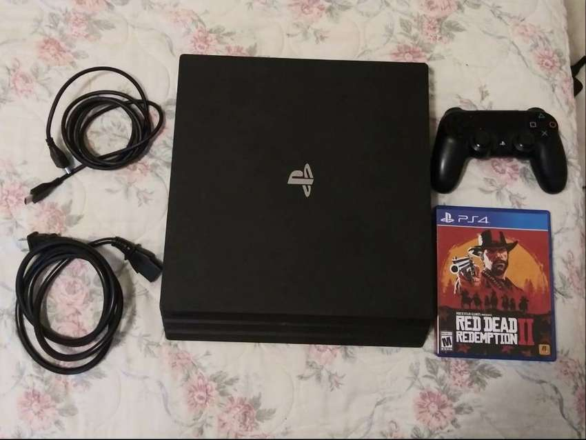 Sony PS4 Pro 1TB , read dead redemption 2 and fifa 19 game 0