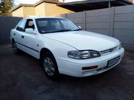 Nice neat and clean 200i automatic Camry start and go disc and papers