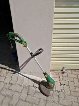 Trimtech lawnmower and weedeater