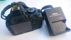 Nikon DSLR camera D3100 with zoom lens 55to200