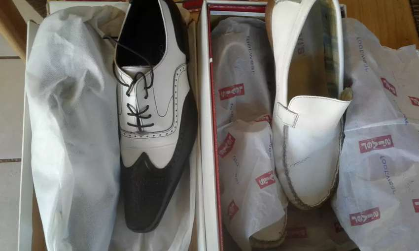 Two pair of shoes for sale Cignal and Levi's size 10