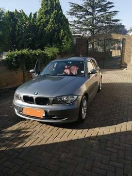 2010 BMW 1 series  with red leather seats.In very neat condition