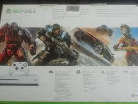 X BOX ONE... 1 TERA BYTE USED 2 TIMES AS NEW WITH WARRANTY. WITH GAMES