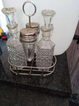 Glass salt and peper and oil and vinegar with standing